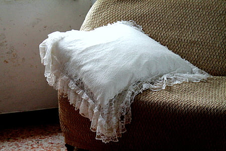 white throw pillow on sofa
