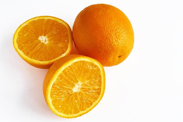 one whole and one sliced orange fruits
