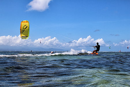 person kitesurfing during daytime