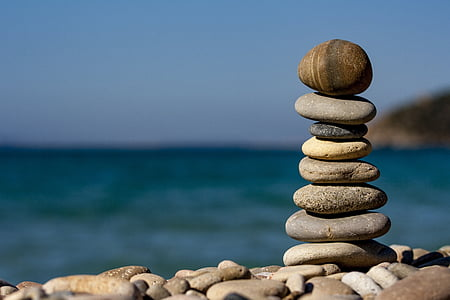 stack of stones near body of water