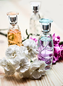 three clear glass spray bottles