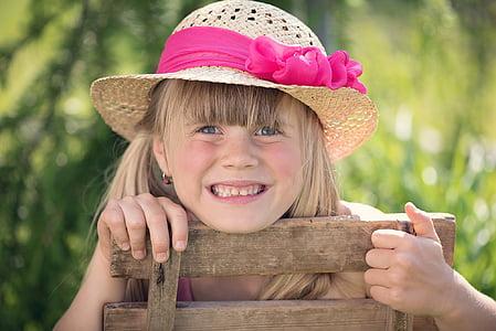 girl wearing brown sun hat