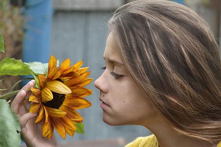girl holding sunflower