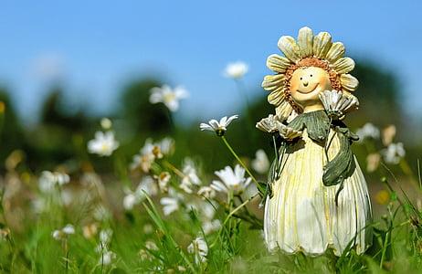white and beige sunflower ceramic figurine