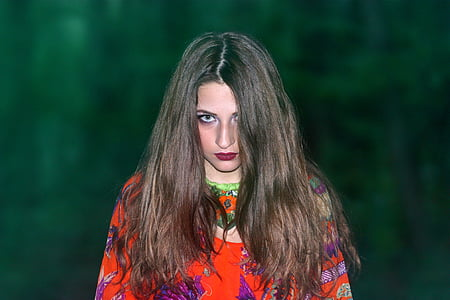 woman standing near green backround