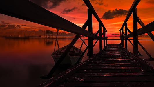 twilight hour on dock under cloudy sky