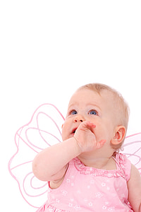 baby wearing butterfly wing eating hand photo