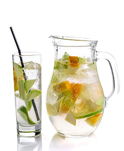 clear glass pitcher and glass cup filled with sliced fruits