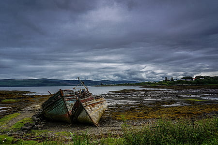 photo of shipwreck docked on land