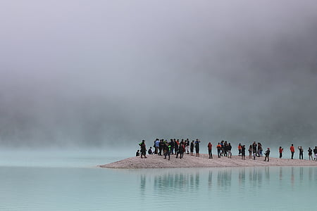 group of people near bodies of water