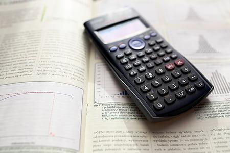 black scientific calculator on book