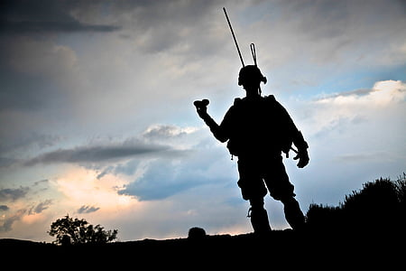 soldier standing during sunset