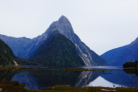 body of water near mountain photography
