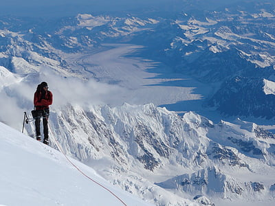 person standing on snowy mountain during day time