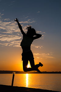 silhouette of woman white jumping