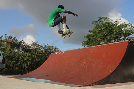 man on mid air with skateboard