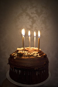 chocolate cake with five candles