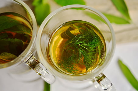 tea filled clear glass