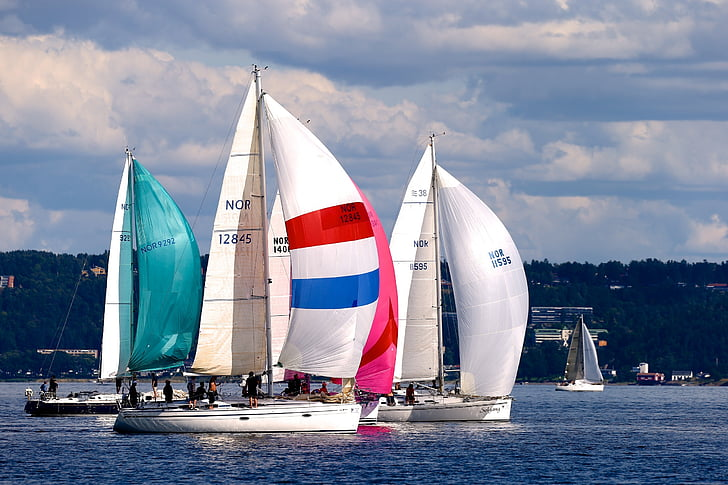 three white sailboats