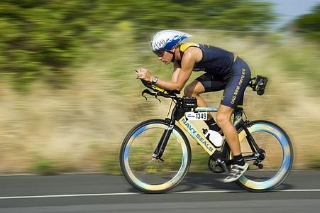 man wearing blue shorts riding bicycle