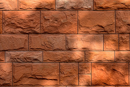 close up photography red brick wall during daytime