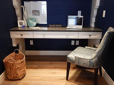 brown fabric chair near desk