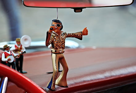 selective focus photography of Elvis Presley ornament hanging on rear view mirror