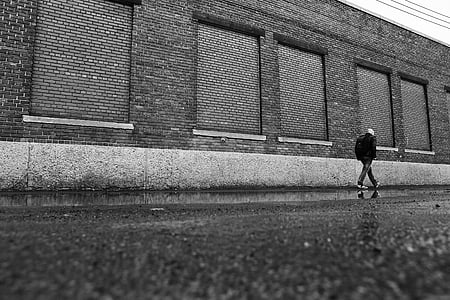 person wearing jacket in grayscale photorgraphy