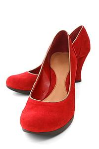pair of red suede wedges