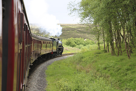 steam train on rail during daytime