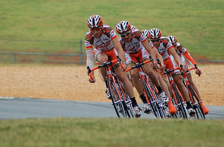 four men riding bicycle on race
