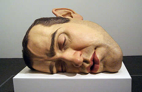 person's head on top of white surface