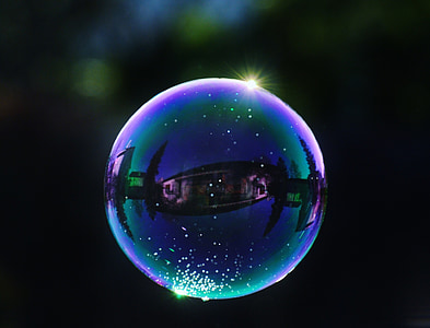 selective focus photography of bubbles at night time