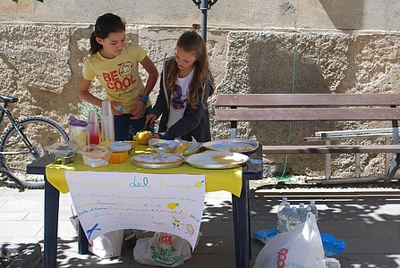 two girls near table during daytime