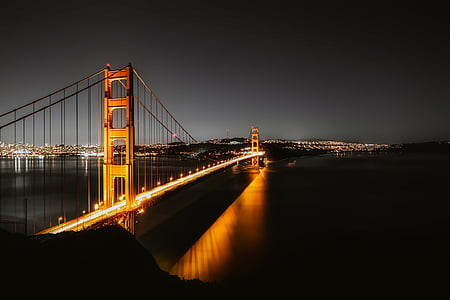 time lapse photography of golden gate during night