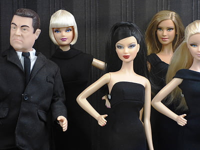 four female and one male toy dolls