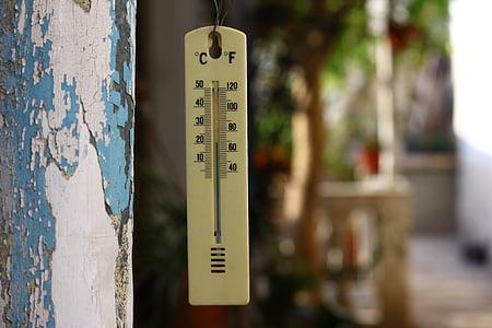 termometer hanging during daytime