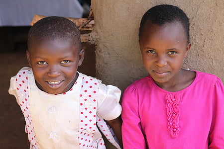 two girls sitting taking group picture