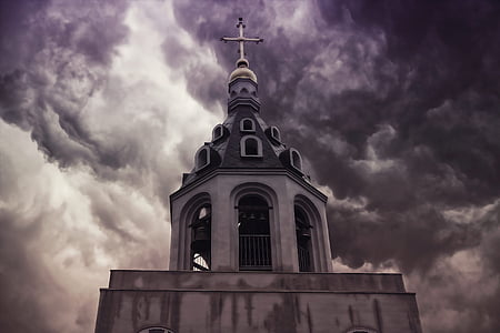landscape photography of church under cloudy sky