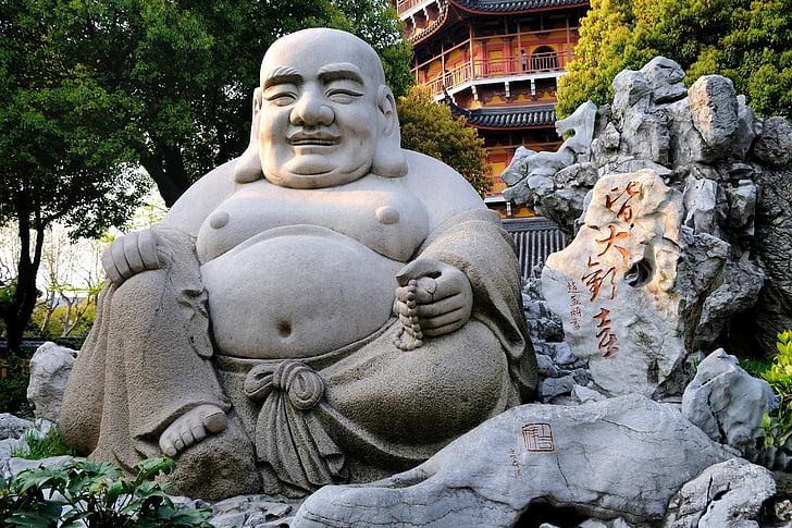 Hotei Buddha statue during daytime