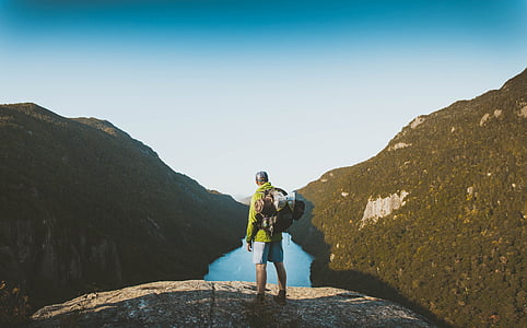 man standing in front of valley
