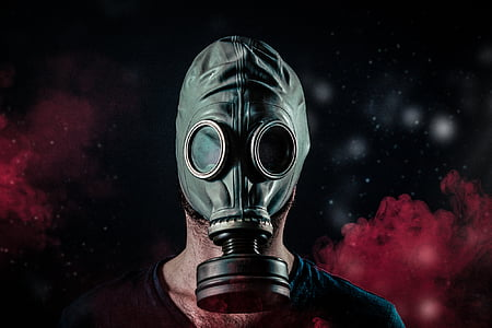 person wearing gray gas mask