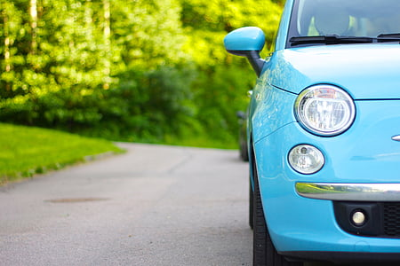 closeup photo of teal FIAT 500 hatchback