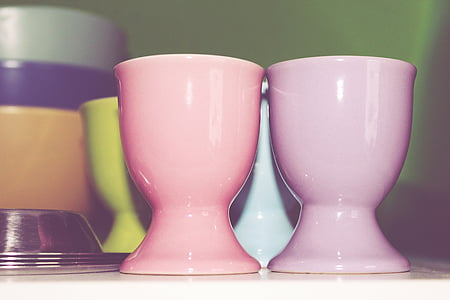 closeup photo of two pink ceramic cups