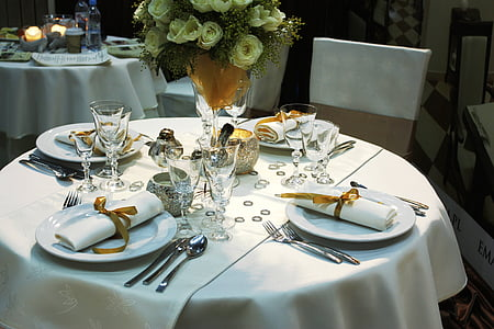 plates, utensils, and napkins on table