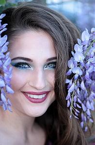 shallow focus photo of woman hiding on purple flowers