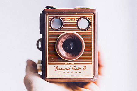 person holding vintage camera