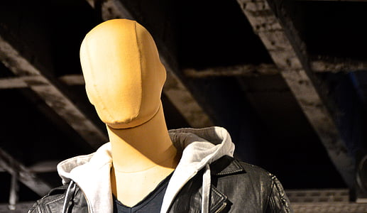 brown mannequin with black leather jacket