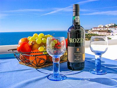 Rozes wine bottle near drinking glass