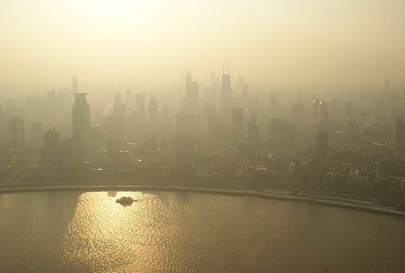 aerial photo of city skylines during foggy day